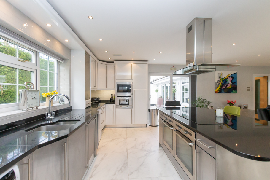 Modern kitchen with white gloss units